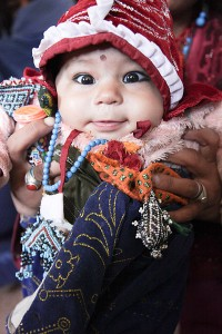An_Afghan_woman_holds_up_baby_boy_for_the_camera,_during_a_women_medical_engagement_at_Operation_Spartan_Stork_on_Dasht_Camp,_Kandahar_province,_Afghanistan,_Oct._26,_2011_111026-A-VB845-015